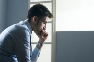 Tired pensive businessman